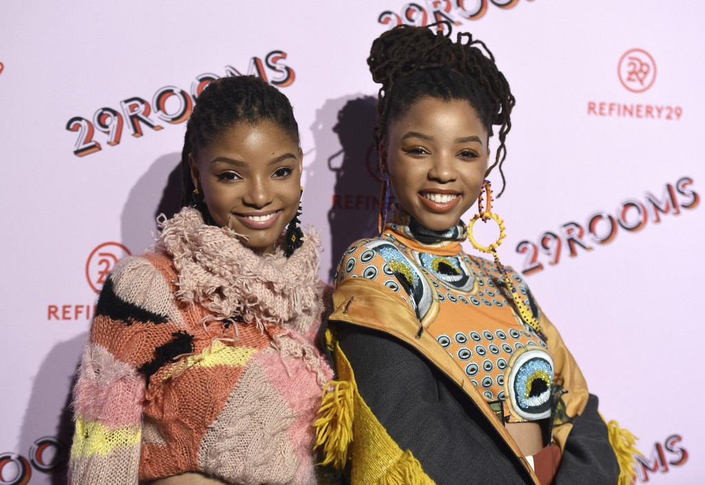 FILE - In this Dec. 6, 2017 file photo, Halle Bailey, left, and Chloe Bailey, of Chloe x Halle, appear at the West Coast debut of 29rooms  in Los Ange...