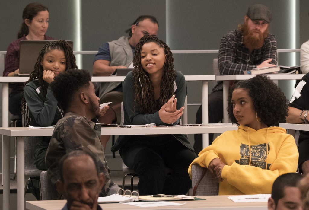 """This image released by Freeform shows Halle Bailey, from left, Trevor Jackson, Chloe Bailey and Yara Shahidi in an episode of, """"grown-ish,"""" a spin-off..."""