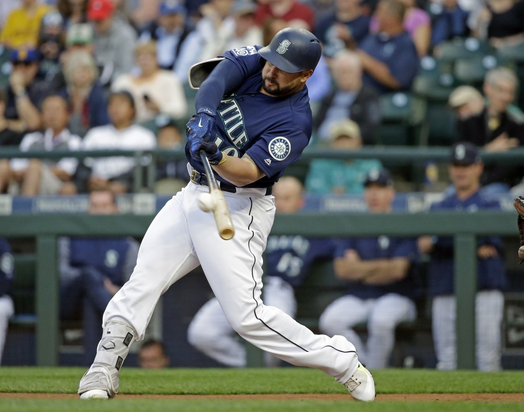 FILE - In this Aug. 14, 2017, file photo, Seattle Mariners' Yonder Alonso doubles against the Baltimore Orioles in the first inning of a baseball game...