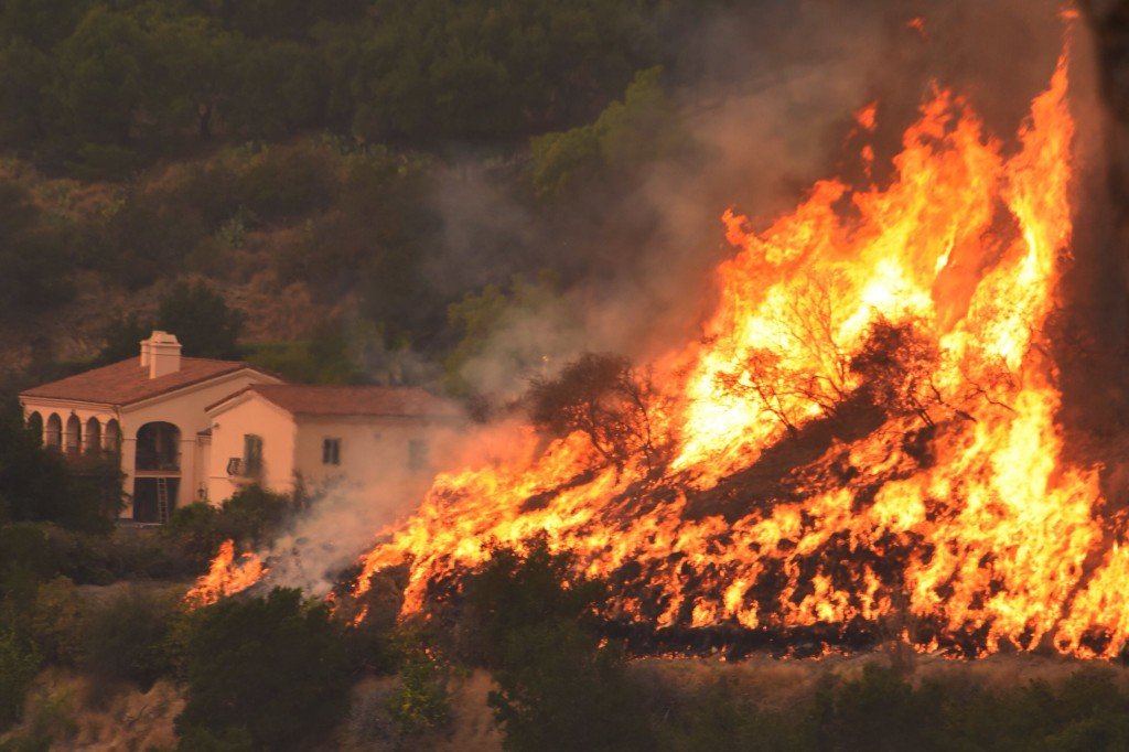 FILE - In this Thursday, Dec. 14, 2017, file photo provided by the Santa Barbara County Fire Department, flames from a back firing operation underway ...