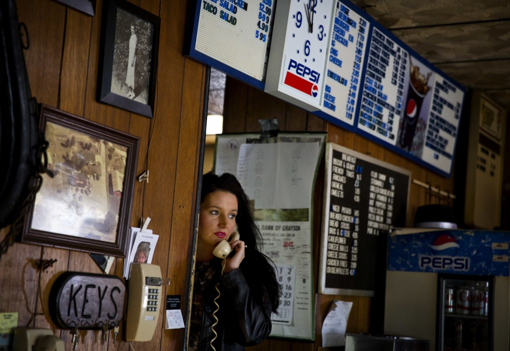 Angela Whitley answers the phone in the Frosty Freeze restaurant where she works in Sandy Hook, Ky., Wednesday, Dec. 13, 2017. Whitley, 32, has four k...