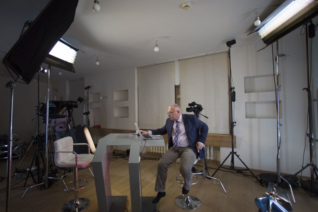 In this Wednesday, Dec. 10, 2014 photo, Dozhd Channel anchor Pavel Lobkov, prepares for a broadcast in their studio-apartment in Moscow, Russia. In De...