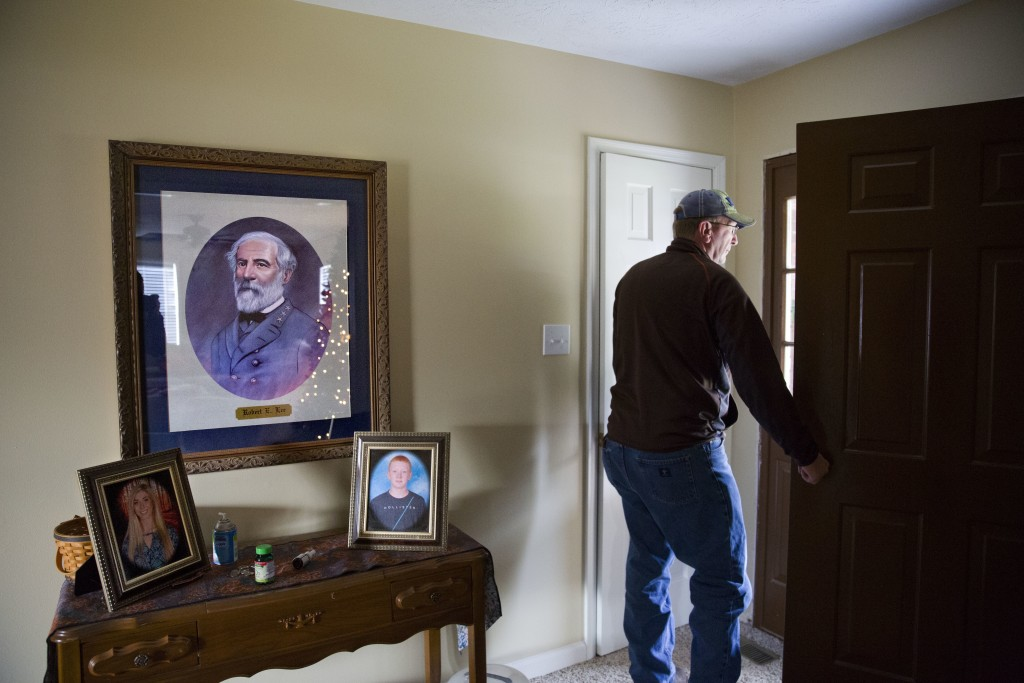 A portrait of Confederate Gen. Robert E. Lee hangs above images of his children in the home of Reggie Dickerson in Sandy Hook, Ky., Wednesday, Dec. 13...
