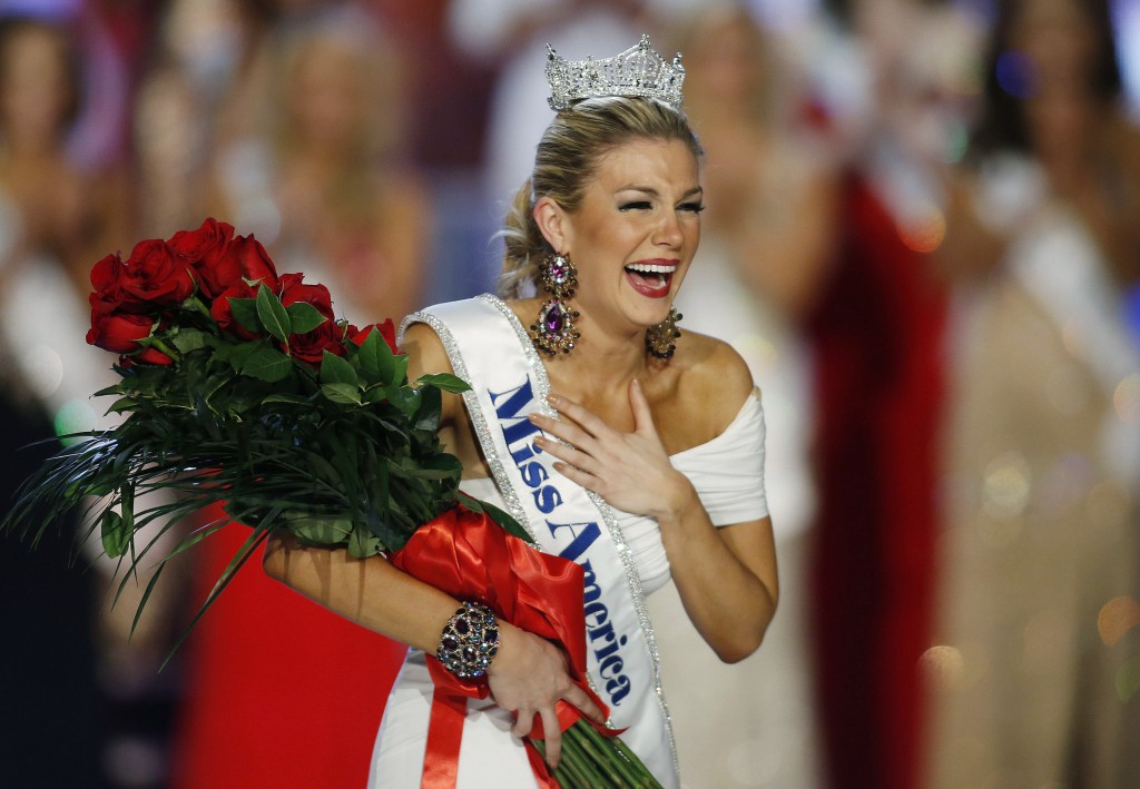 FILE - In this Jan. 12, 2013 file photo, Miss New York Mallory Hytes Hagan reacts as she is crowned Miss America 2013 in Las Vegas. Some former Miss A...