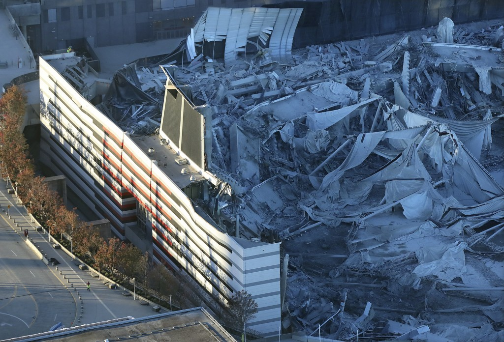 FILE - In this Nov. 20, 2017, file photo, a section of the stadium remains standing after the implosion of the Georgia Dome in Atlanta. (Curtis Compto...
