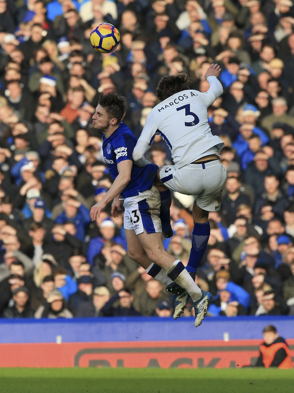 Everton's Jonjoe Kenny, left, and Chelsea's Marcos Alonso battle for the ball during the English Premier League soccer match between Everton and Chels...
