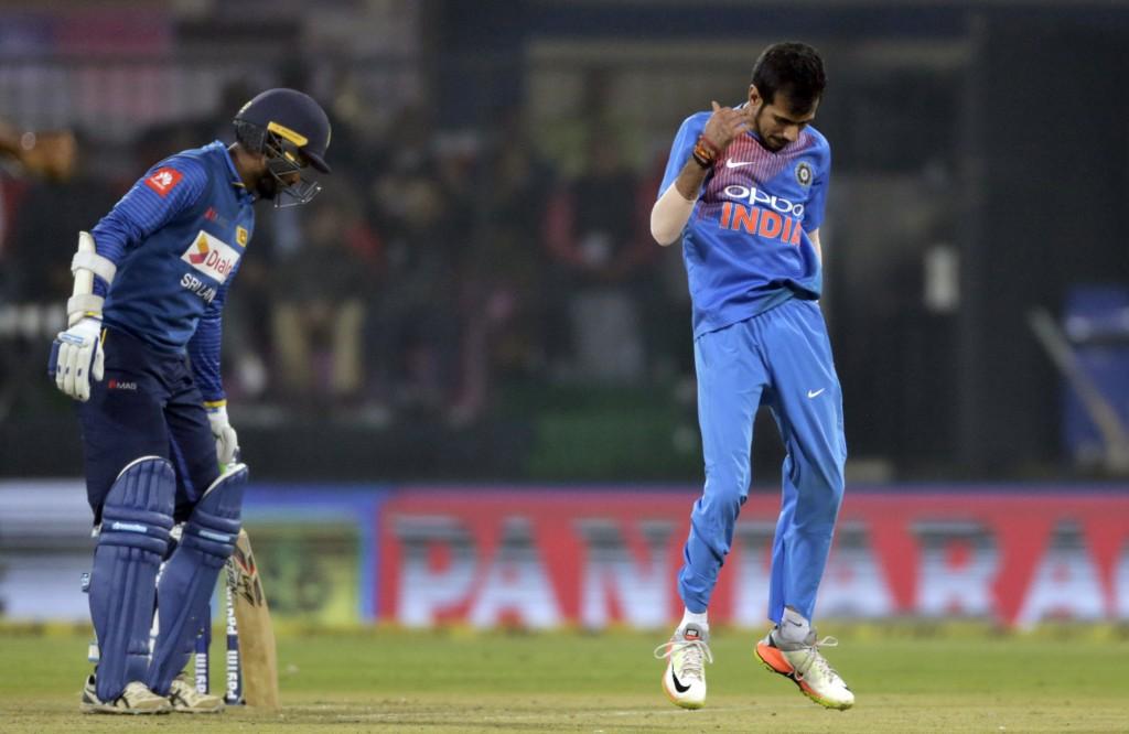 India's Yuzvendra Chahal, right, celebrates the dismissal of Sri Lanka's Upul Tharanga, left, during their second Twenty20 international cricket match...