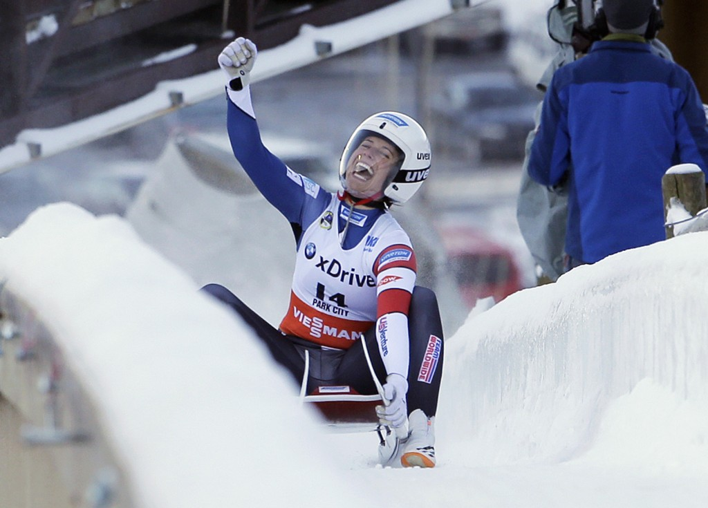 FILE - In this Dec. 17, 2016, file photo, second place finisher Emily Sweeney, of the United States, celebrates as she slides to the finish after a wo...