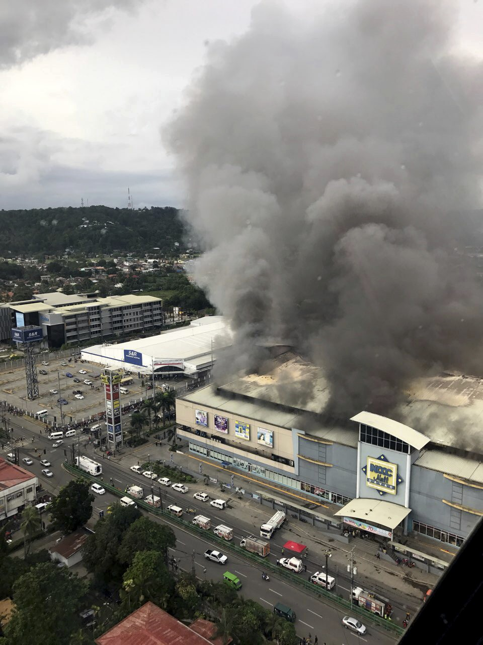 In this photo provided by Special Assistant to the President Christopher Bong Go, a fire rages at  shopping mall in Davao city, the hometown of Philip...