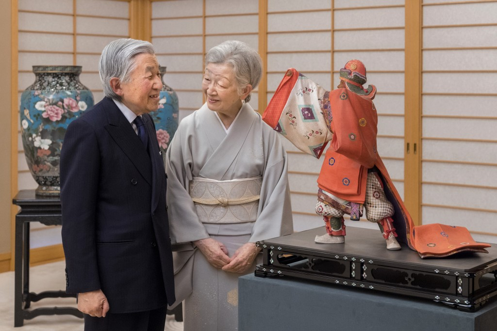 In this Dec. 6, 2017, photo provided by the Imperial Household Agency of Japan, Emperor Akihito talks with Empress Michiko at Imperial Palace in Tokyo...