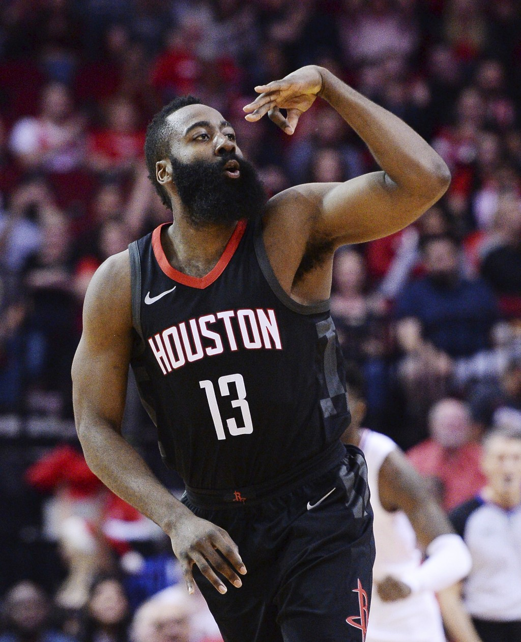 Houston Rockets guard James Harden celebrates a 3-point shot against the Los Angeles Clipers early in an NBA basketball game Friday, Dec. 22, 2017, in...
