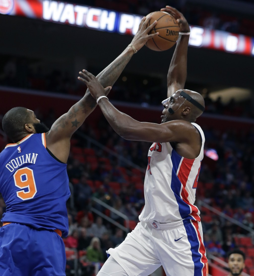 New York Knicks center Kyle O'Quinn (9) blocks a shot by Detroit Pistons forward Anthony Tolliver during the first half of an NBA basketball game, Fri...