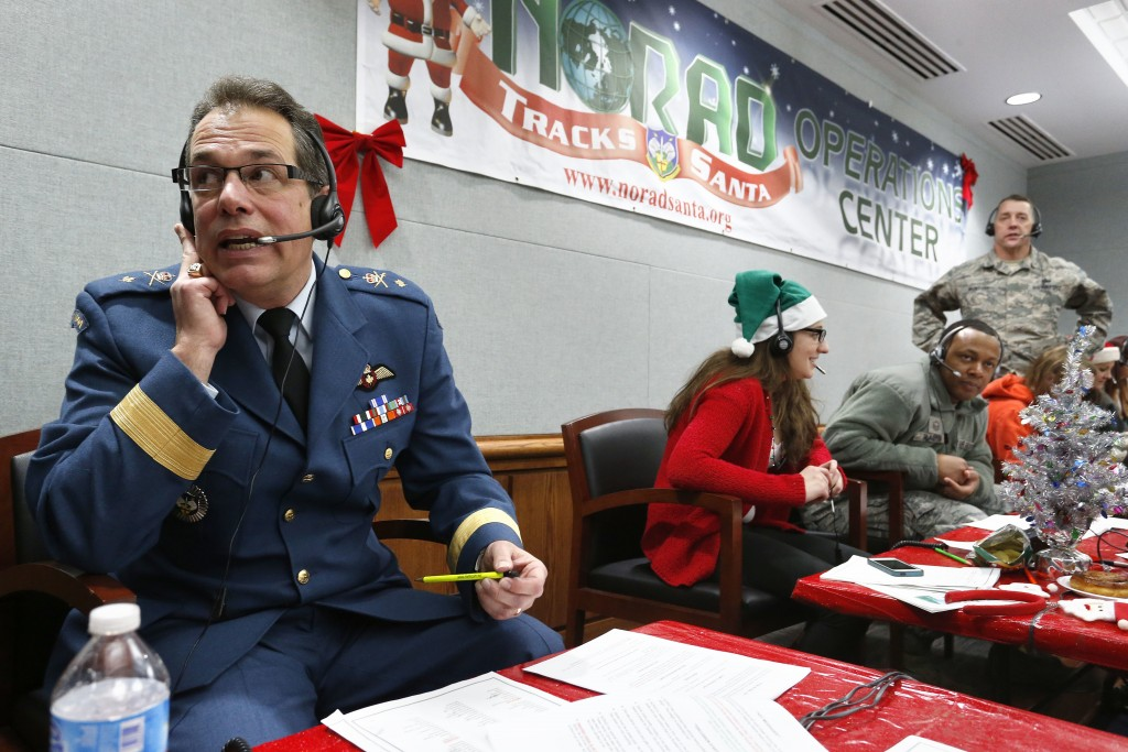 FILE - In this Dec. 24, 2014, file photo, Canadian Brig. Gen. Guy Hamel, NORAD and USNORTHCOM Deputy Director of Policy, Strategy, and Plans, joins ot...