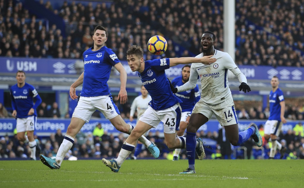 Everton's Jonjoe Kenny, centre and Chelsea's Tiemoue Bakayoko battle for the ball, during the English Premier League soccer match between Everton and ...