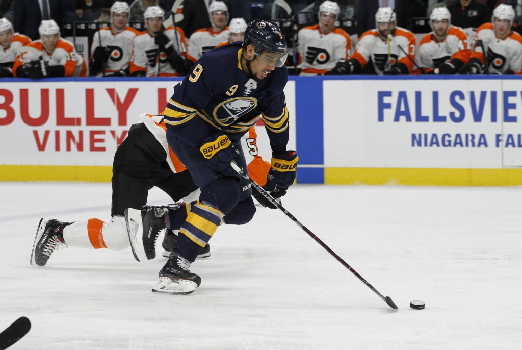 Buffalo Sabres forward Evander Kane (9) skates the puck into the zone during the first period of an NHL hockey game against the Philadelphia Flyers, F...