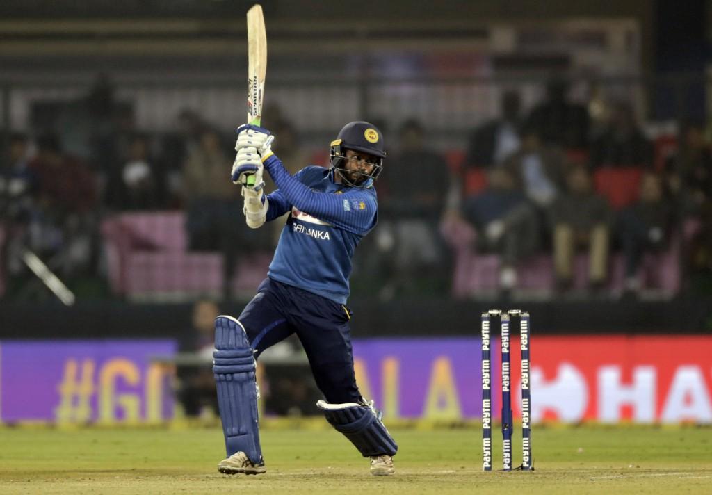 Sri Lanka's Upul Tharanga plays a shot during their second Twenty20 international cricket match against India in Indore, India, Friday, Dec. 22, 2017....