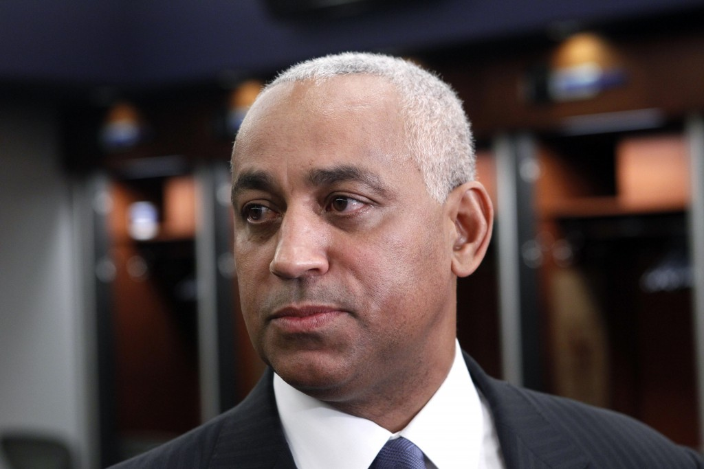 FILE - In this Oct. 4, 2010, file photo, Omar Minaya speaks to the media in the New York Mets clubhouse at Citi Field in New York. Minaya is returning...