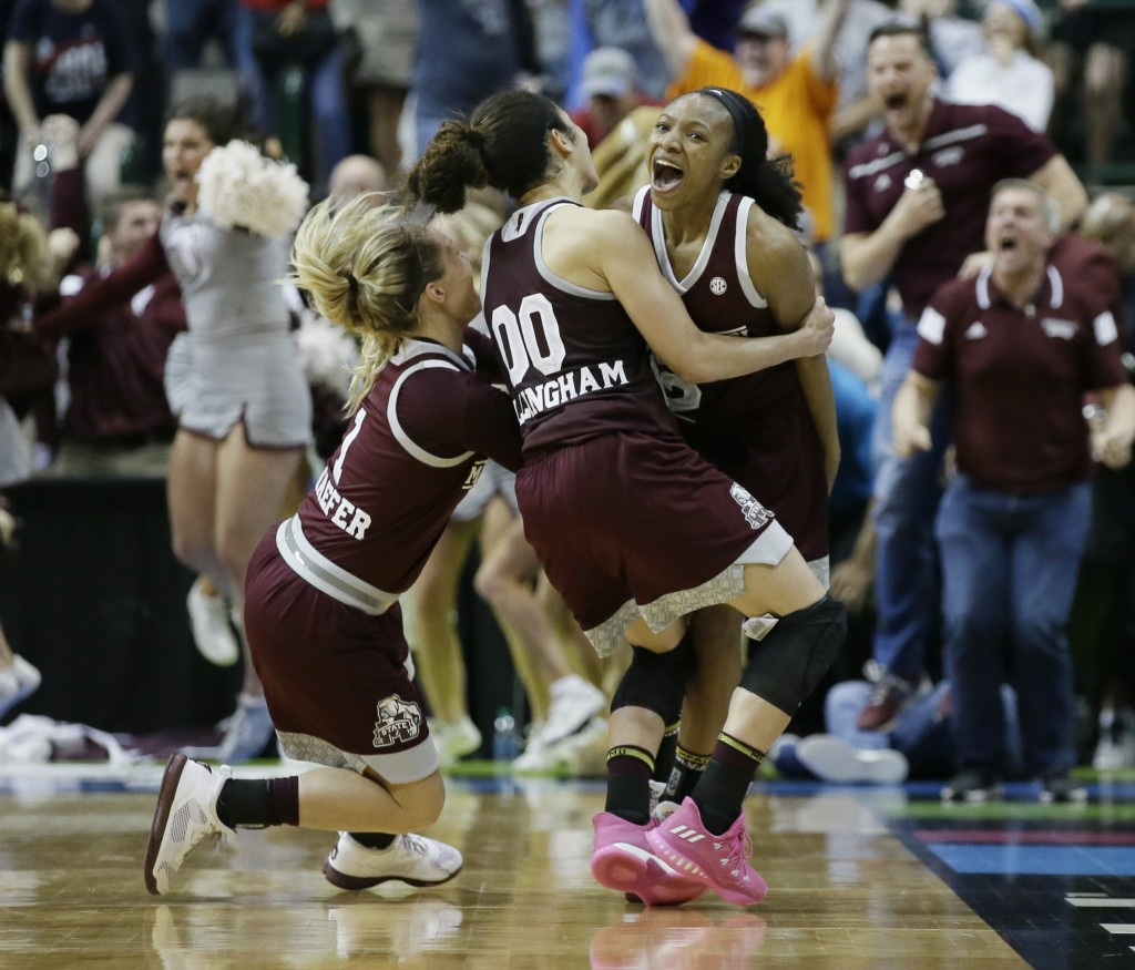 FILE - In this March 31, 2017, file photo Mississippi State guard Morgan William (2) celebrates with teammates after hitting a buzzer-beater basket to...