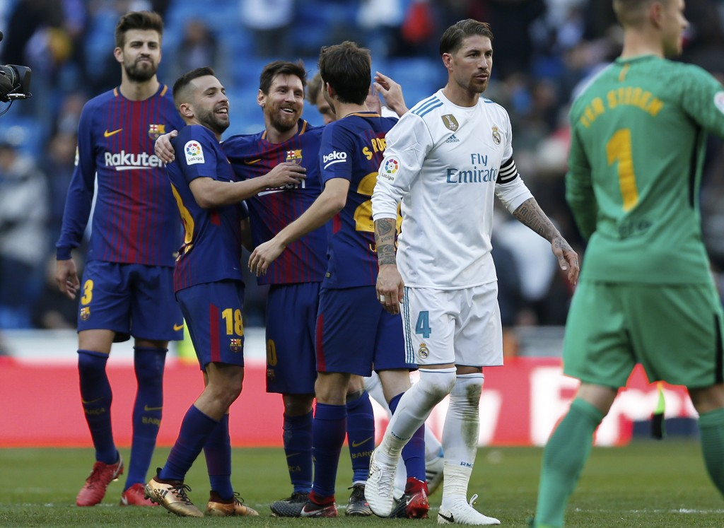 Barcelona's Lionel Messi, 3rd left, celebrates with his teammates at the end of the Spanish La Liga soccer match between Real Madrid and Barcelona at ...
