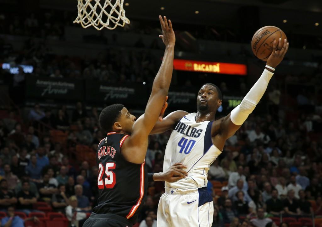 Dallas Mavericks forward Harrison Barnes (40) shoots over Miami Heat center Jordan Mickey (25) in the second quarter of an NBA basketball game, Friday...