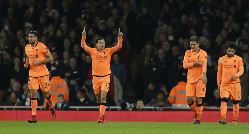 Liverpool's Philippe Coutinho, second left, celebrates after he scoreD the opening goal of the game during their English Premier League soccer match b...