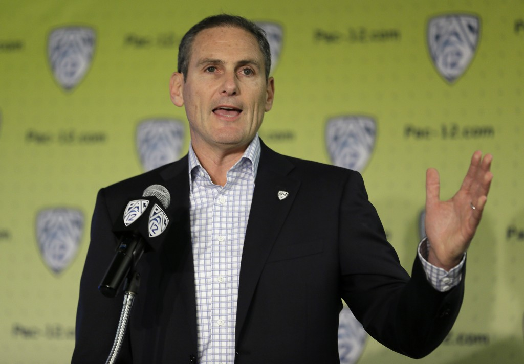 FILE - In this Oct. 12, 2017, file photo, Commissioner Larry Scott gestures while speaking about the formation of a task force on recruitment issues d...