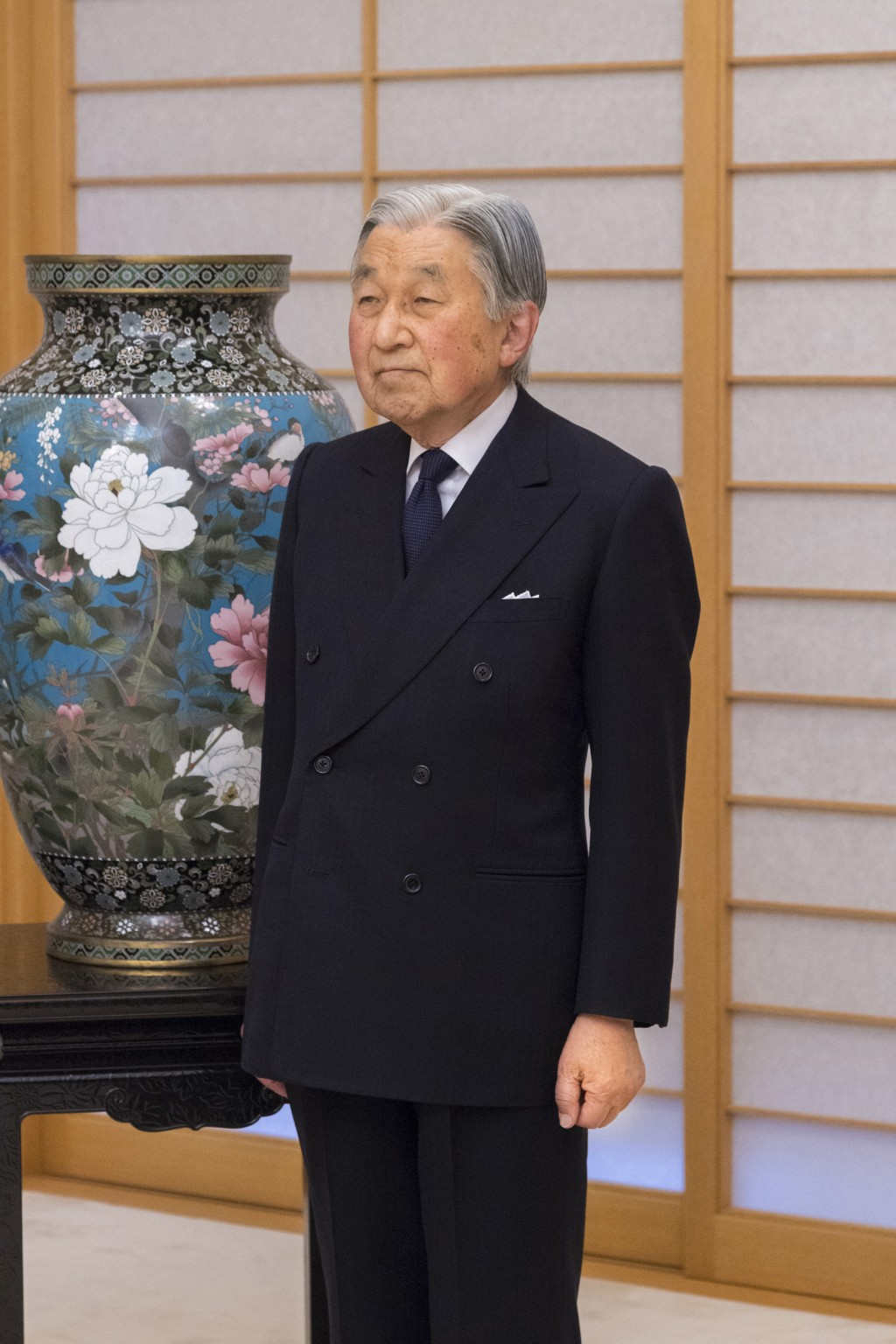 In this Dec. 6, 2017, photo provided by the Imperial Household Agency of Japan, Emperor Akihito poses for a photo at Imperial Palace in Tokyo. Akihito...