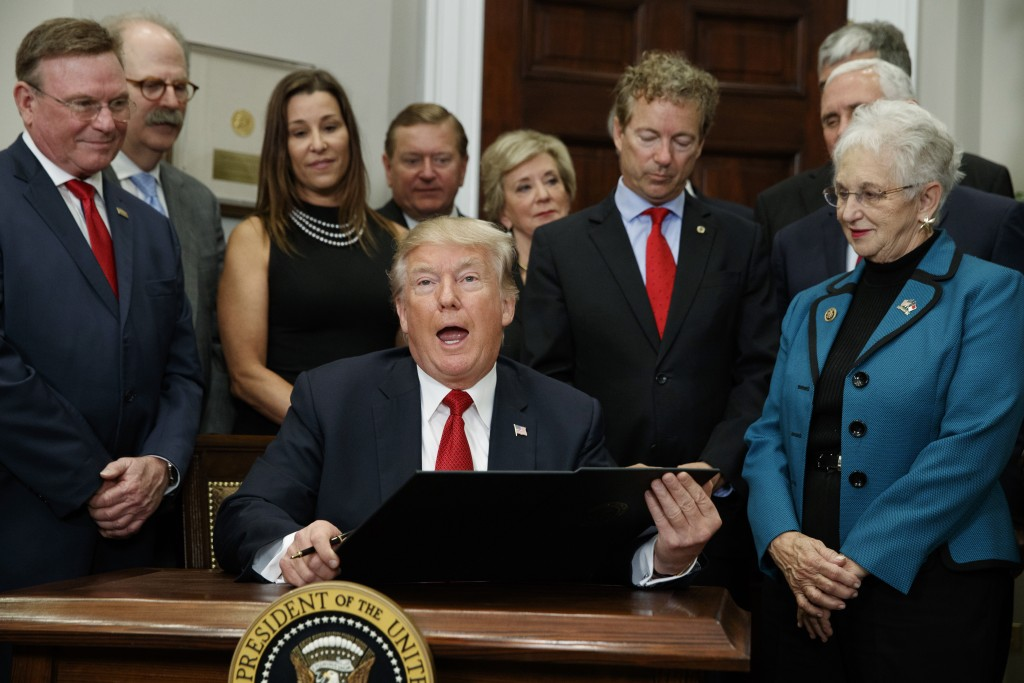 In this Oct. 12, 2017 file photo, President Donald Trump speaks before signing an executive order on health care in the Roosevelt Room of the White Ho...