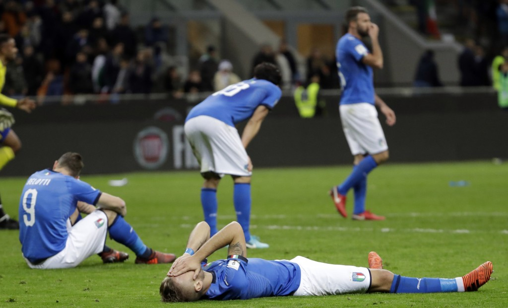 FILE - In this Nov. 13, 2017, file photo, Italy's Ciro Immobile, foreground, and Andrea Belotti, seated left, react to their team's elimination in the...