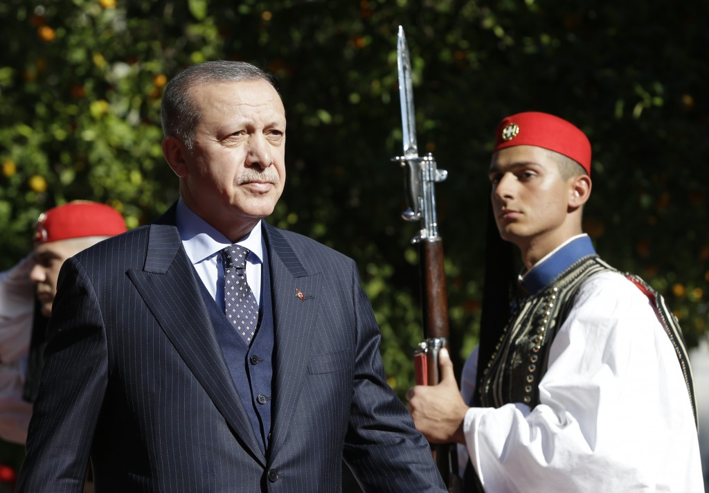 FILE - In this Thursday, Dec. 7, 2017 file photo, Turkey's President Recep Tayyip Erdogan reviews the Presidential Guard during the welcome ceremony i...
