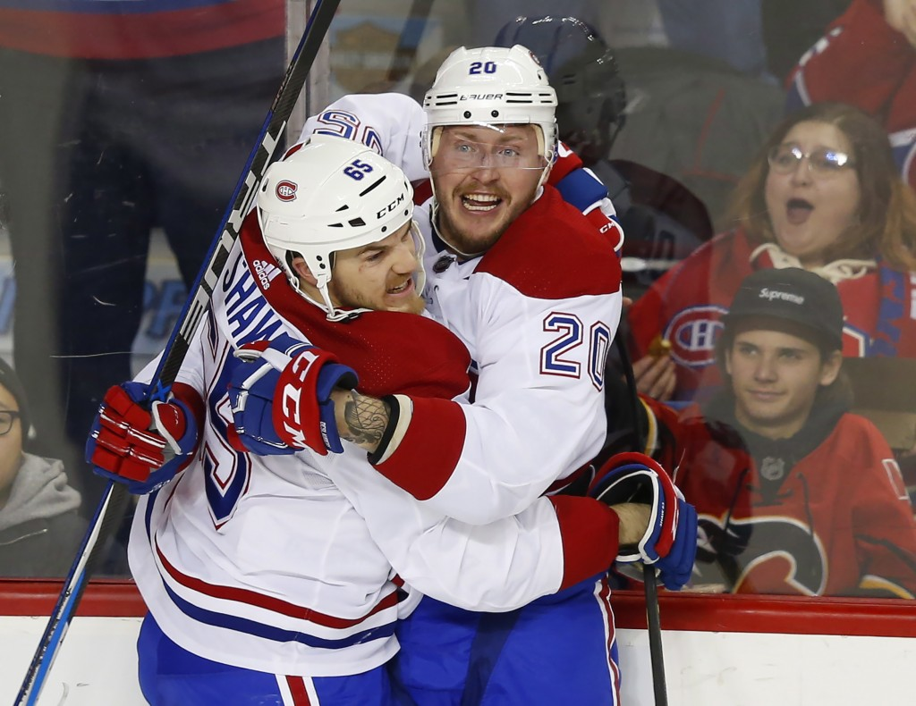 Montreal Canadiens' Nicolas Deslauriers (20) celebrates his goal against the Calgary Flames with teammate Andrew Shaw during the second period of an N...