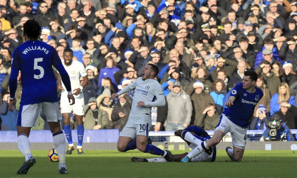 Chelsea's Eden Hazard, centre, reacts after a tackle, during the English Premier League soccer match between Everton and Chelsea, at Goodison Park, in...