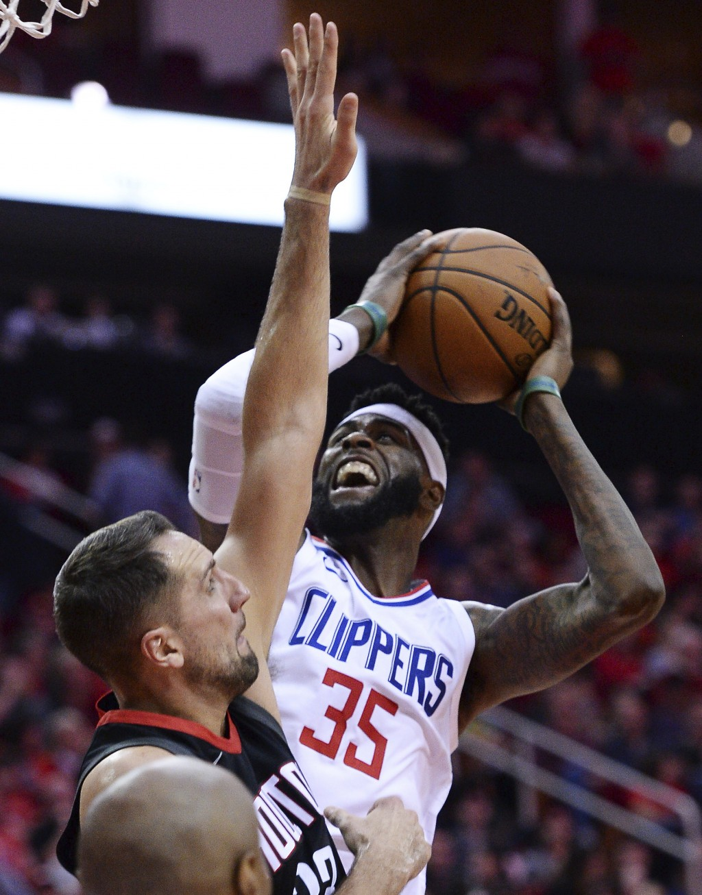 Los Angeles Clippers Willie Reed (35) shoots over Houston Rockets forward Ryan Anderson during the first half of an NBA basketball game Friday, Dec. 2...