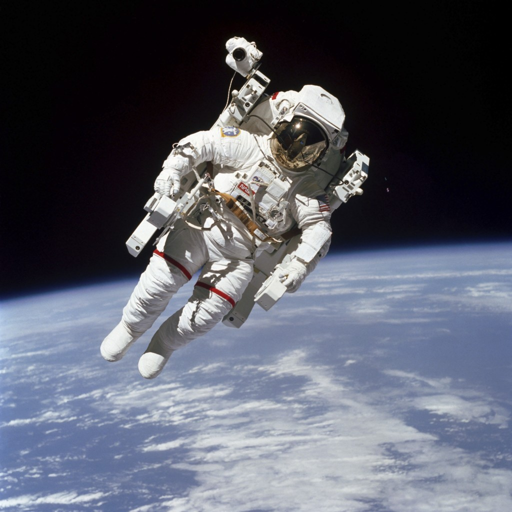 This Feb. 7, 1984 photo made available by NASA shows astronaut Bruce McCandless II, participating in a spacewalk a few meters away from the cabin of t...