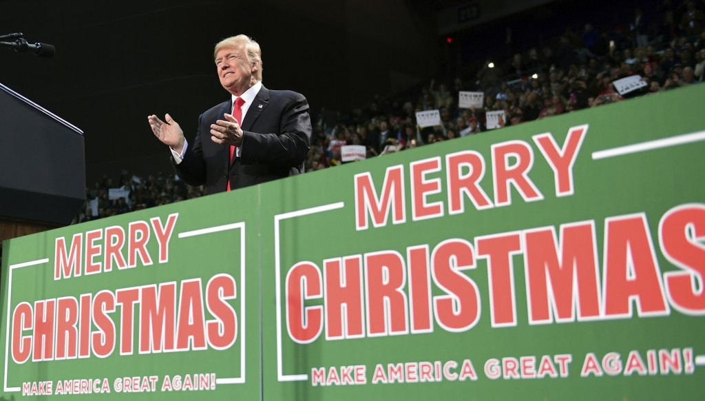 FILE - In this Dec. 8, 2017, file photo, President Donald Trump takes to the stage at a campaign-style rally at the Pensacola Bay Center, in Pensacola...