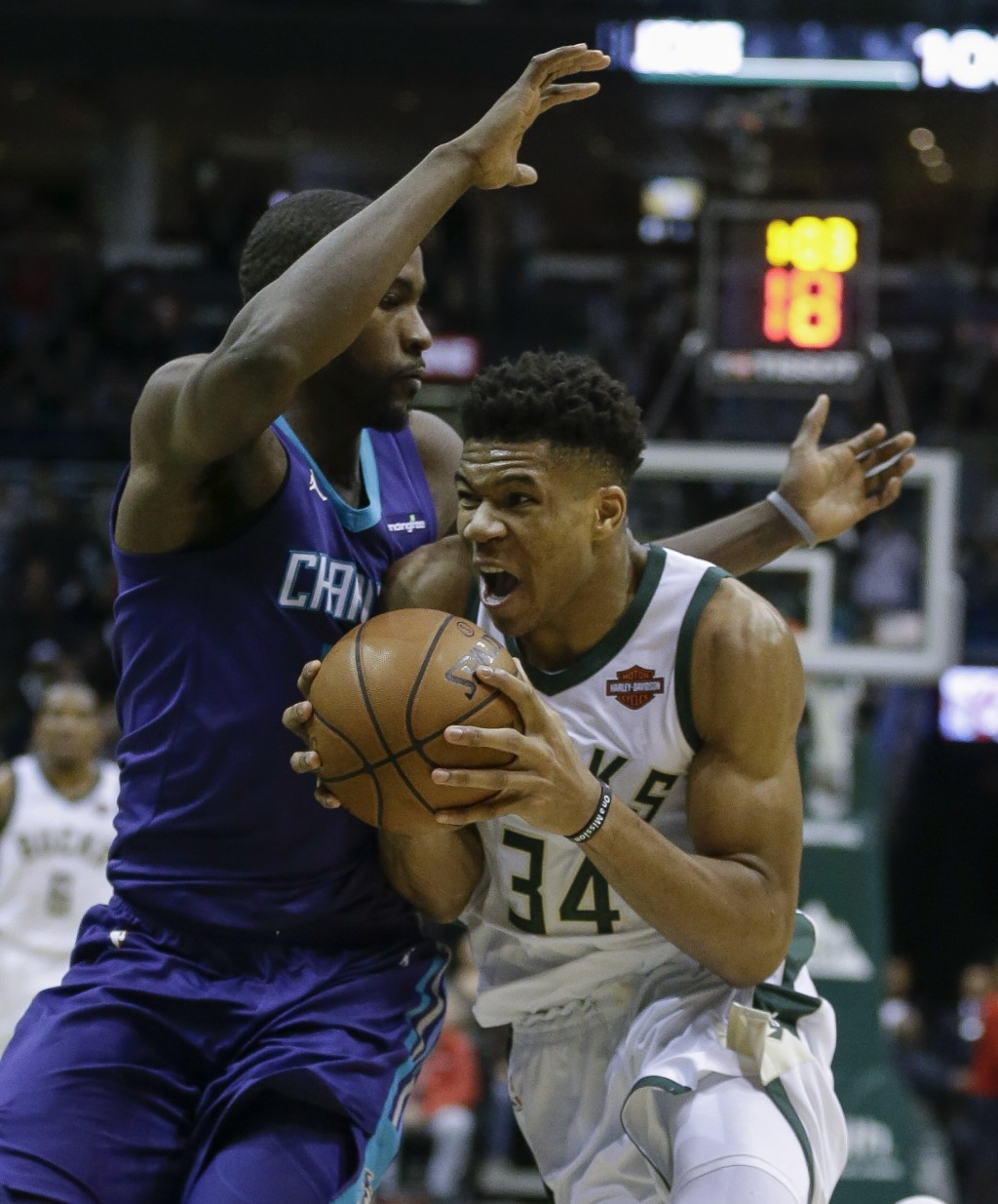 Milwaukee Bucks' Giannis Antetokounmpo, right, drives the ball against Charlotte Hornets' Michael Kidd-Gilchrist during the first half of an NBA baske...