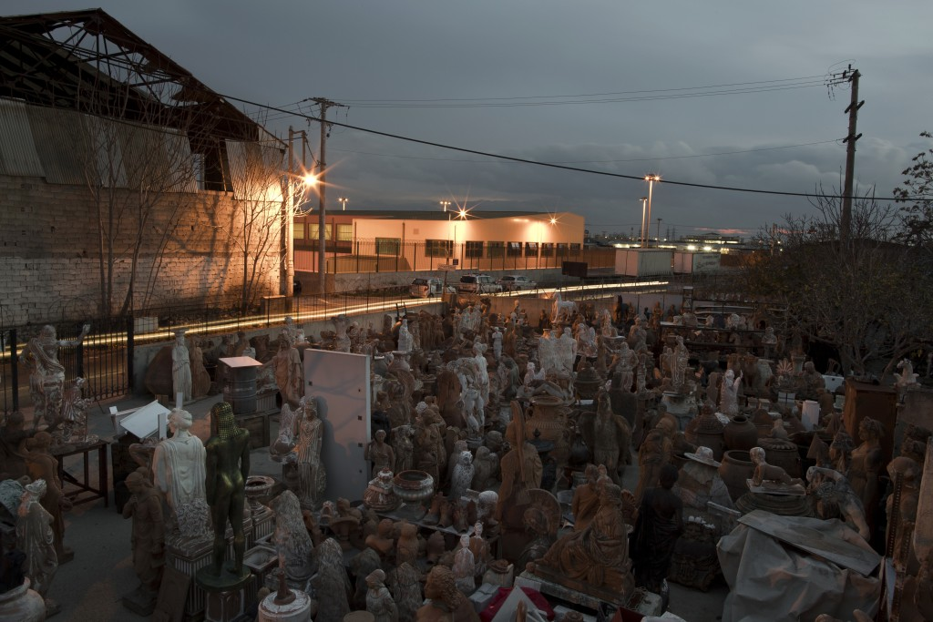 In this Tuesday Dec. 19, 2017 photo, terracotta statues, busts, antefixes and flower pots stands in the yard of Haralambos Goumas' sculpture and ceram...