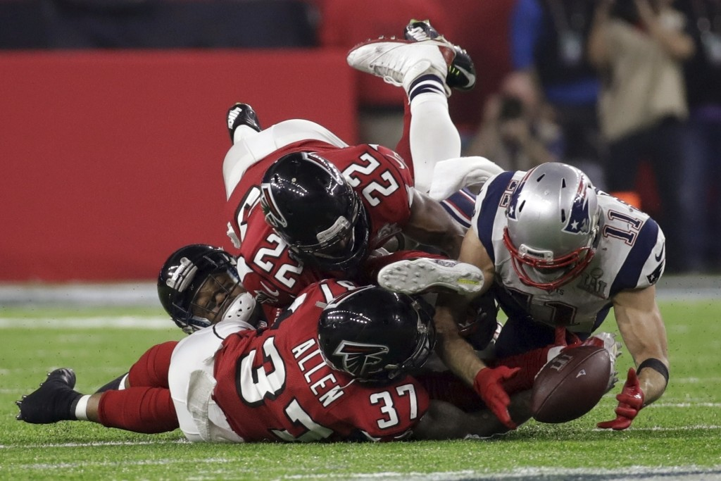 FILE - In this Feb. 5, 2017, file photo, New England Patriots' Julian Edelman (11) makes a catch as Atlanta Falcons' Ricardo Allen and Keanu Neal defe...