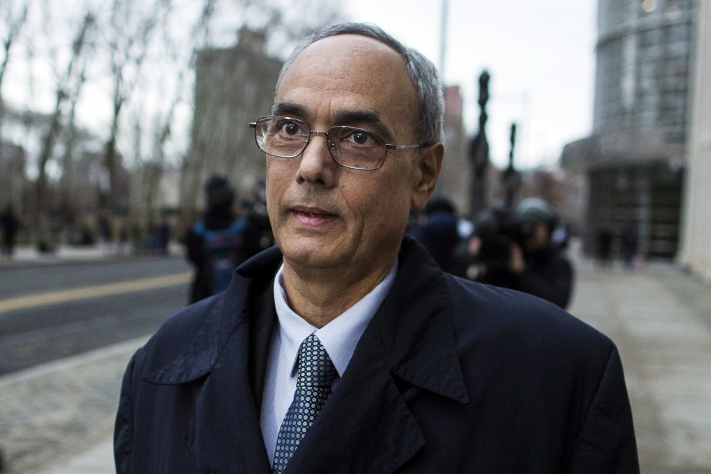 Manuel Burga, the former president of Peru's soccer federation, leaves federal court in the Brooklyn borough of New York, Friday, Dec. 22, 2017. Two f...