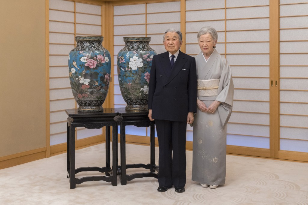 In this Dec. 6, 2017, photo provided by the Imperial Household Agency of Japan, Emperor Akihito with Empress Michiko poses for a photo at Imperial Pal...