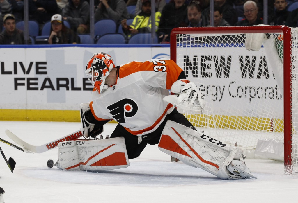 Philadelphia Flyers goalie Brian Elliott (37) makes a pad save during the first period of an NHL hockey game against the Buffalo Sabres, Friday, Dec. ...