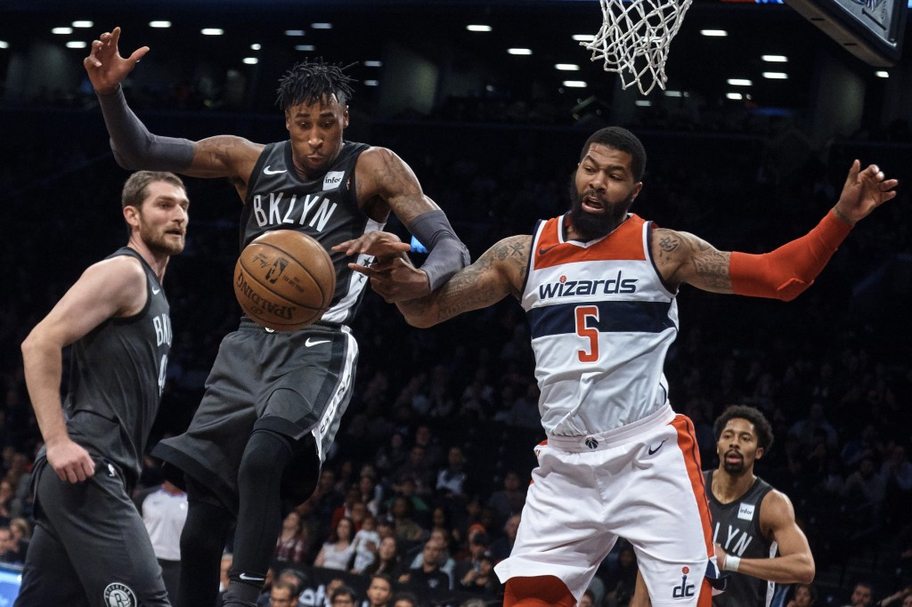 Washington Wizards' Markieff Morris, right, competes for the ball with Brooklyn Nets' Rondae Hollis-Jefferson during the first half of an NBA basketba...