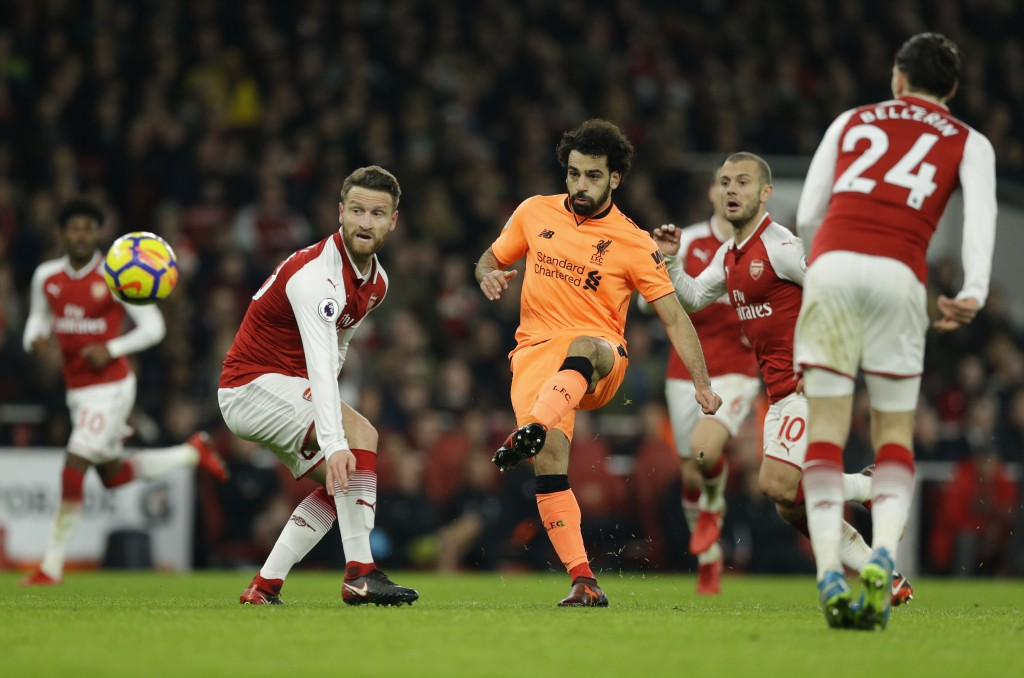 Liverpool's Mohamed Salah shoots and scores his sides 2nd goal of the game during their English Premier League soccer match between Arsenal and Liverp...