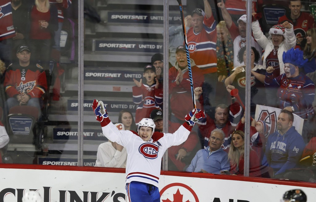 Montreal Canadiens' Brendan Gallagher celebrates his goal against the Calgary Flames during the third period of an NHL hockey game Friday, Dec. 22, 20...