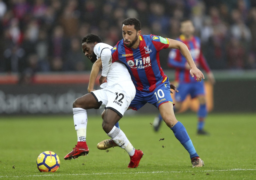 Swansea City's Nathan Dyer, left, and Crystal Palace's Andros Townsend battle for the ball during the English Premier League soccer match at the Liber...