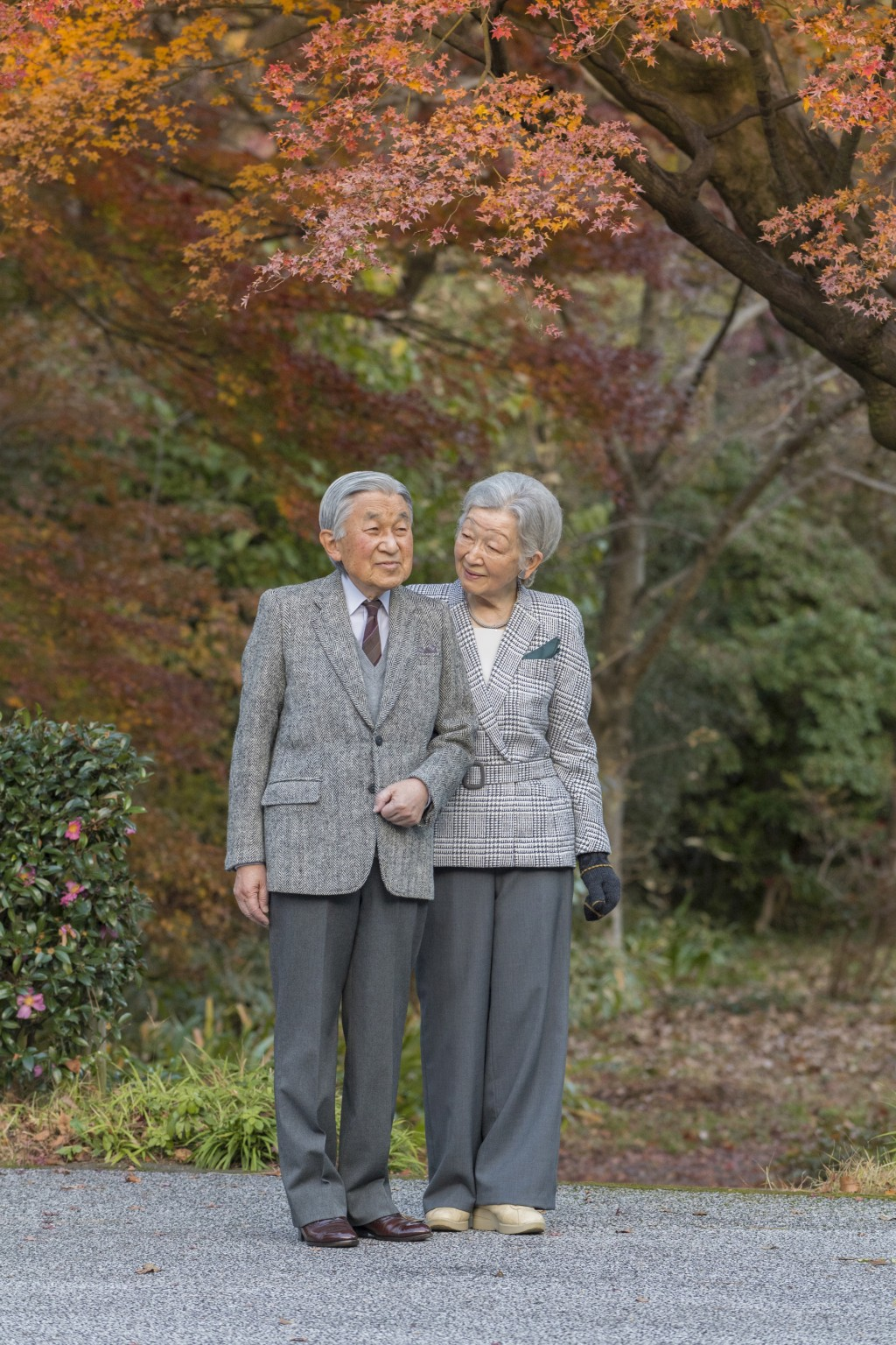 In this Dec. 6, 2017, photo provided by the Imperial Household Agency of Japan, Emperor Akihito and Empress Michiko take a stroll in the garden of Imp...