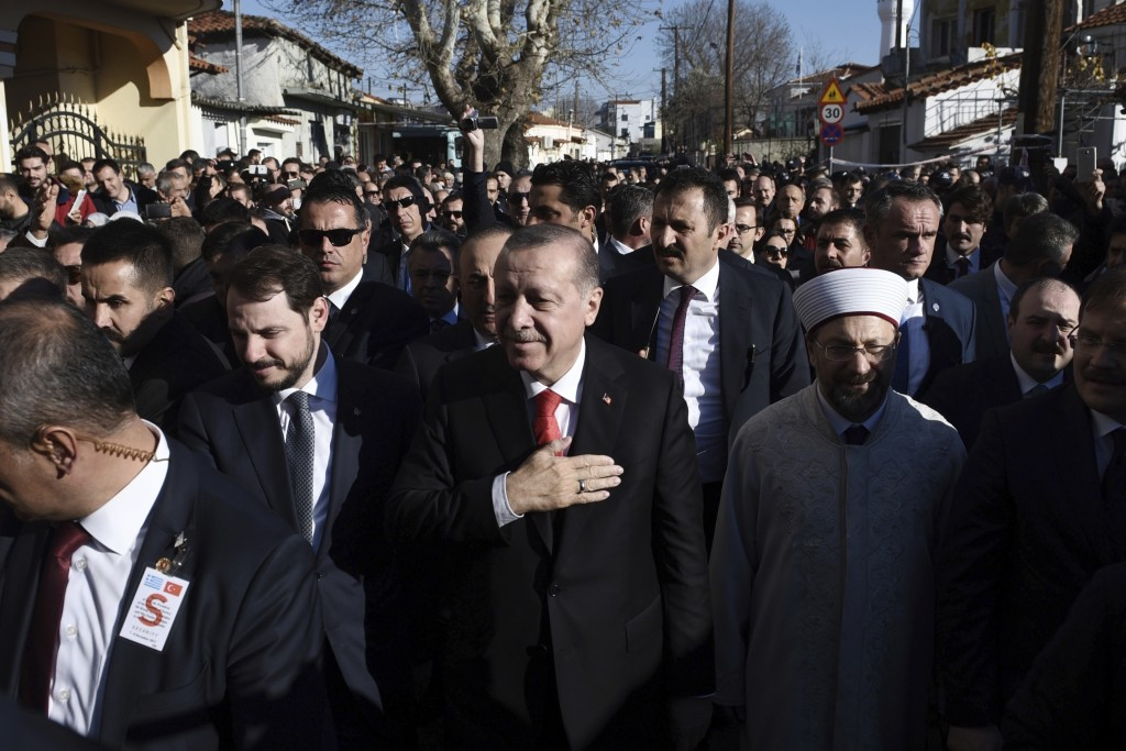 FILE-In this Friday, Dec. 8, 2017 file photo, Turkey's President Recep Tayyip Erdogan, centre, acknowledges the crowd during a visit at the northeaste...