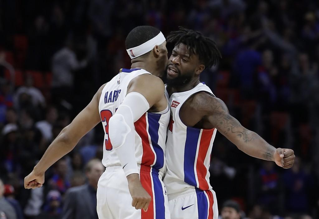 Detroit Pistons forward Tobias Harris, left, and teammate forward Reggie Bullock celebrate their win over the New York Knicks in an NBA basketball gam...