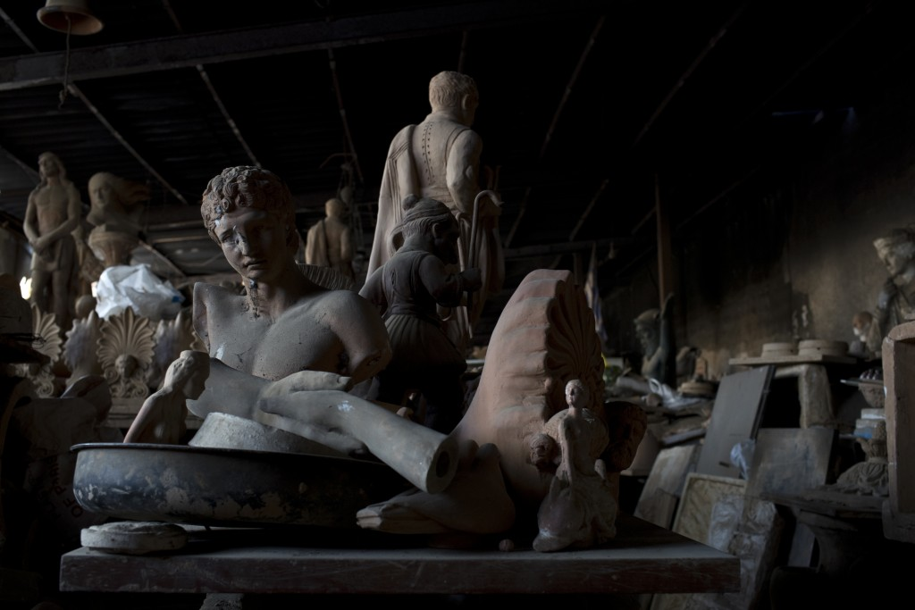 In this Friday, Oct. 13, 2017 photo, the bust of the ancient Greek messenger of the gods, Hermes, left, stands among other statues and antefixes in Ha...