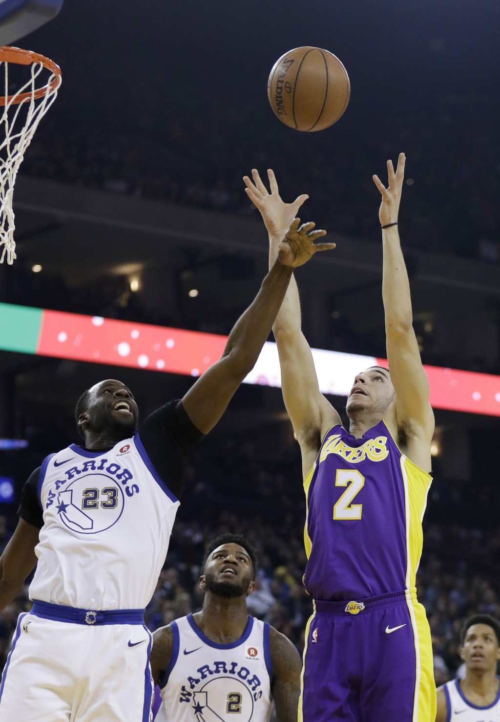 Golden State Warriors forward Draymond Green (23) and Los Angeles Lakers guard Lonzo Ball (2) vie for a rebound during the first half of an NBA basket...